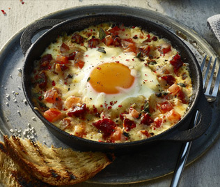 Baked Corn Fed Eggs with Tomatoes, Chorizo & Manchego Cheese
