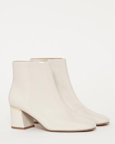 Gallery Ecru Patent Boots